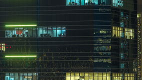 Windows in modern city office building at night timelapse. stock video