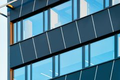 Windows of modern corporate business office building. Concept royalty free stock photo