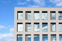 Windows in a modern office block reflect the sky Stock Images