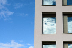 Windows in a modern office block reflect the sky Stock Image