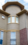 Windows on Modern Stucco Condo Building Stock Photos
