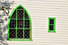 Windows of a Modest Rural Church. Pretty windows of a small historic rural church in Ontario Canada. The bright green window frames stand out against the white stock images