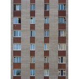 Windows, windows and more windows. A wall of the apartments building with many windows. People are living behind these windows in similar flats Stock Image