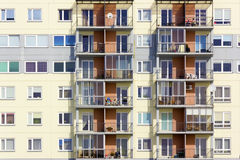 Windows of a multiroom apartment house Stock Photos