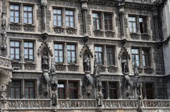 Windows of Munich`s new town hall at Marienplatz in Germany royalty free stock image