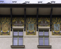 Windows with murals. The last floor of a historic building on the street deputies in Krakow Stock Image