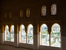 The Windows of the Nasrid palaces on a summer day, Granada. GRANADA, SPAIN - MAY 13, 2016: Windows of   Nasrid Palaces, Alhambra Royalty Free Stock Images