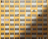 Windows of a new building at sunrise. Windows of a new building ready for owners to move in Stock Photos