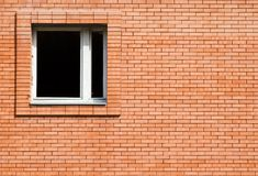 Windows of the new house. Window and textures of red facing brick Royalty Free Stock Photos