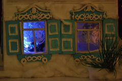The windows in the New Year night. Magic photo of shining windows with new year tree Stock Images