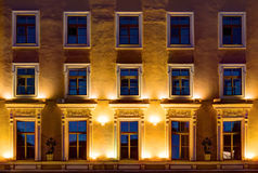 Windows on night facade of office building Royalty Free Stock Image