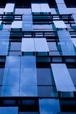 Windows of office building. Sky reflecting in windows of office building Royalty Free Stock Photography