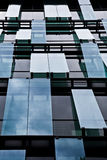 Windows of office building. Sky reflecting in windows of office building Stock Photography