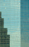Windows of office buildings. Cool business background Stock Image