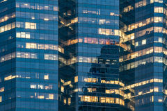 Windows of office buildings, corporate skyscrapers in Bangkok. Royalty Free Stock Images