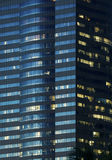 Windows of office buildings illuminated at night Royalty Free Stock Images