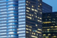 Windows of office buildings illuminated at night Royalty Free Stock Photos