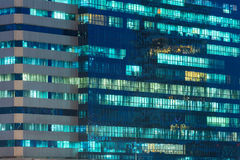 Windows of office buildings illuminated at night Stock Image