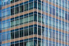 Windows of office buildings, Modern business background. Jakata Stock Image