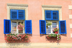 Windows with old blue wood shutters Royalty Free Stock Photos