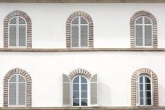 Windows of old building facade Stock Photos