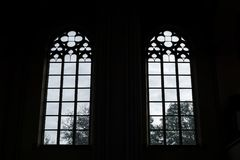 Windows of an old building from the inside. Outside the windows the sky and trees royalty free stock photos