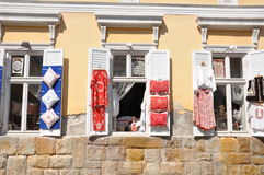 Windows of an old building in Szentendre with exposed folk handicrafts Stock Photo