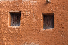 Windows on the old clay wall. Clay adobe building in the Golden Horde reconstructed capital Stock Photography