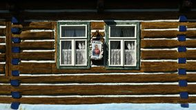 Folk Wooden Architecture, Stara Lubovna Museum, Slovakia. Windows of old folk wooden house with traditional folk and religious decorations in Stara Lubovna open stock photography