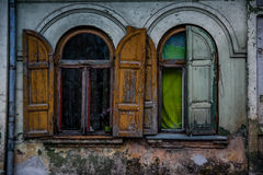 Windows of an old historic building. In town of Kuldiga, Latvia. Shot at dusk Royalty Free Stock Photos