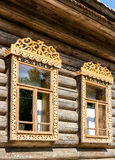 Windows of old house with carved wooden trim Royalty Free Stock Photos