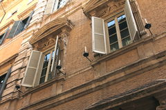 Windows of old house. Mediterranean architecture in Rome, Italy. Royalty Free Stock Photography