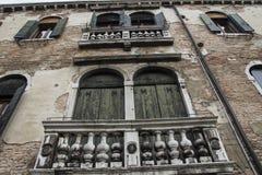 Windows. Old house in Venice, Italy Stock Photos