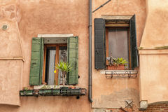 Windows of old house in Venice Stock Photo