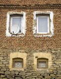 Windows. Old and new windows in the same house Stock Photo
