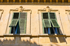 Windows with old open shutters Stock Images