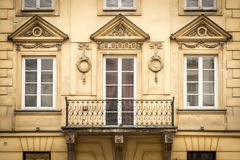 Windows in the old residential building in the european style. In Warsaw, Poland royalty free stock photo