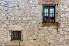 Windows in old stone house. Detail of windows in old stone house in a Extremadura rural village. Copy space Royalty Free Stock Image