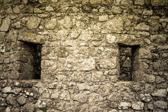 Windows in the old stone wall Stock Photos