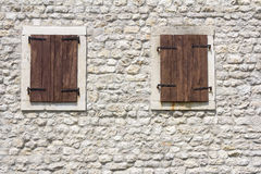 Windows in the old stone wall Stock Images