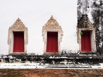 The windows of the old temple at Wat-chom-phu-wek Thailand. Royalty Free Stock Photo