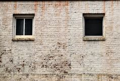 Windows in old white brick building  Stock Photo