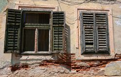 Windows with old wood shutters Royalty Free Stock Image