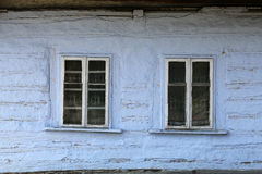 Windows of old, wooden cottage Royalty Free Stock Images