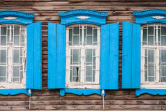 Windows of old, wooden cottage in the countryside Stock Photos