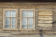 The windows of an old wooden dilapidated house. Social problem Stock Image
