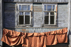 Windows in an old wooden house Stock Image