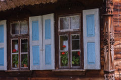Windows on old wooden house Royalty Free Stock Image
