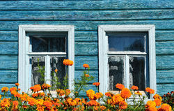 Windows of an old wooden house Stock Photography