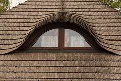 Windows on old wooden roof Stock Images